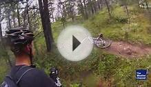 Grizzly bear charges at mountain bikers